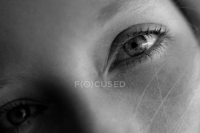 Medelln, Colombia - 2018.togoa-sepulveda Closeup of young woman eyes on black and white looking at camera — Stock Photo