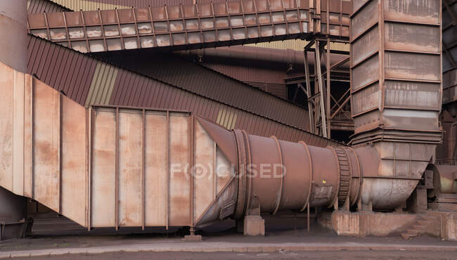 Exterior of steel factory with metal pipes placed outside  building in Asturias — Stock Photo