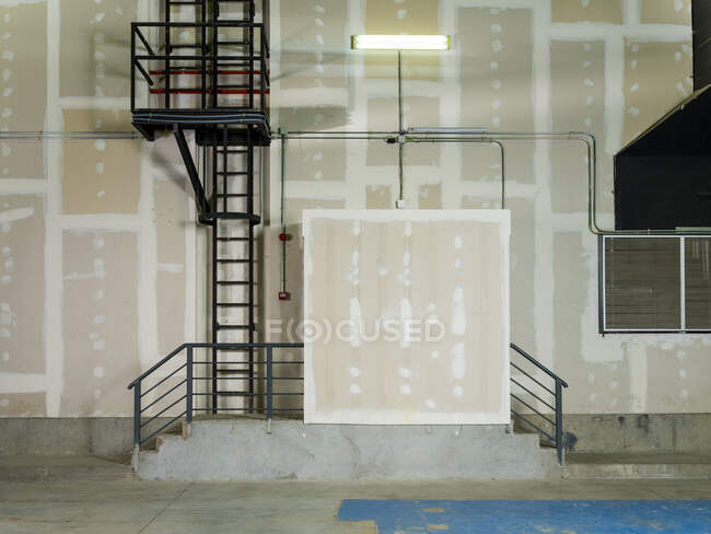 Exterior of plant with walls covered with plasterboard during renovation and prepared for plastering — Stock Photo