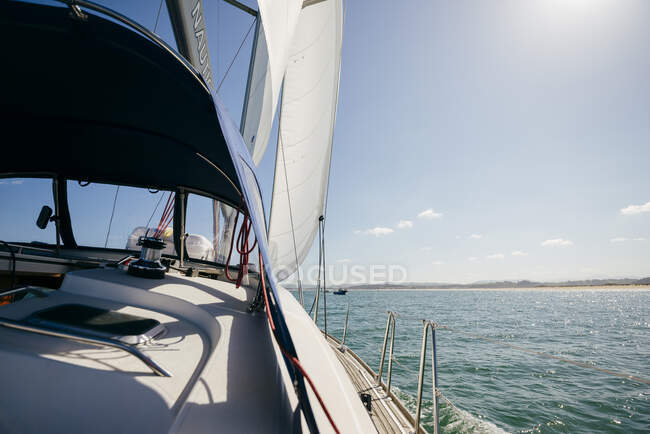 Modern motorboat floating on rippling sea water in sunny summer day with blue sky — Stock Photo