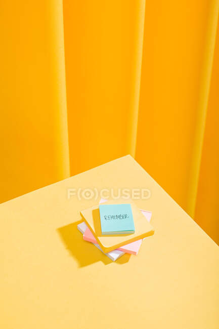 A bunch of colorful notes in a yellow table — Stock Photo