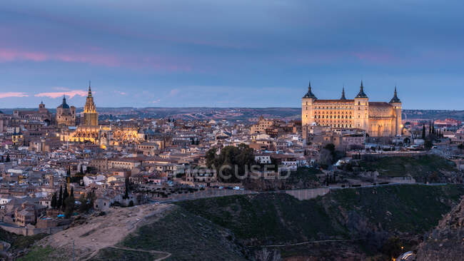 From above cityscape of aged town with medieval houses and castles during sunset — Stock Photo