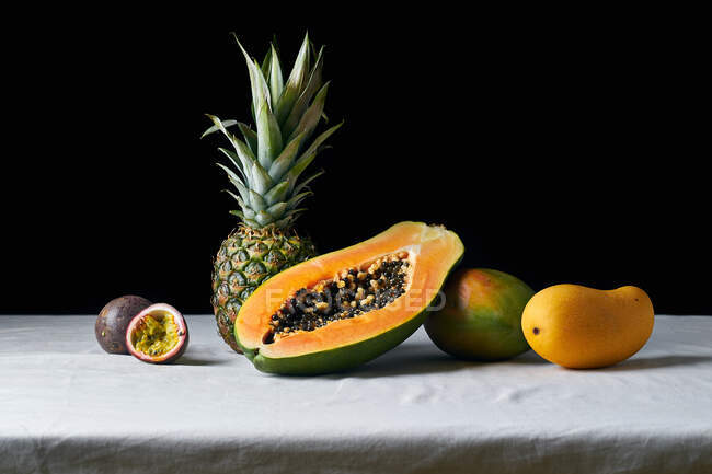 Still life with pineapple, papaya, mango and passion fruit — Stock Photo