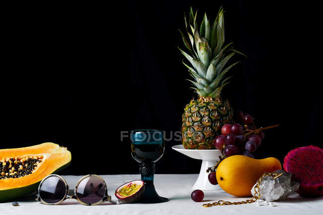 Still life with tropical fruits, gems and various objects — Stock Photo
