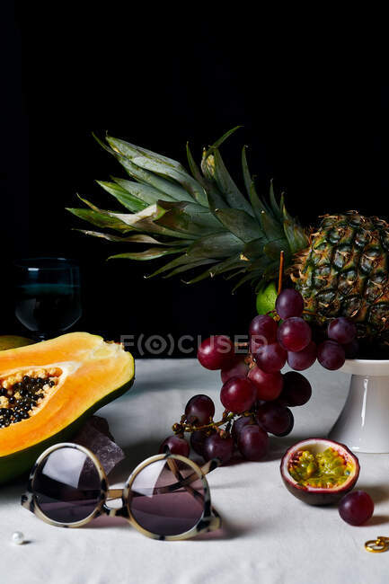 Still life with tropical fruits, gems and sun glasses — Stock Photo