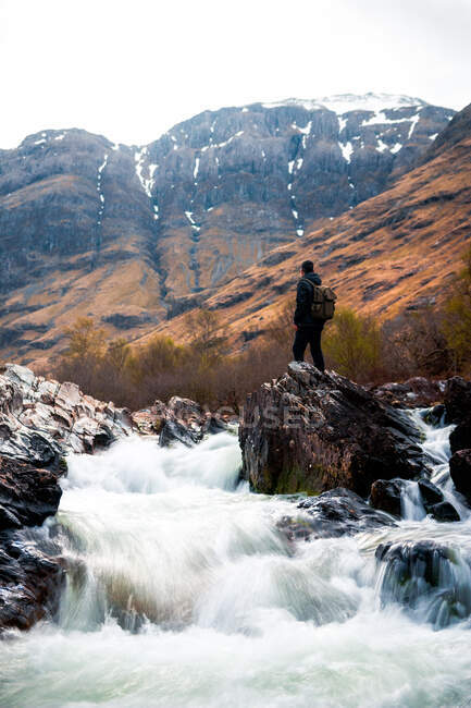 Rough natural landscape with mountain river streaming among rocky highland in cloudy day in Scotland — Stock Photo