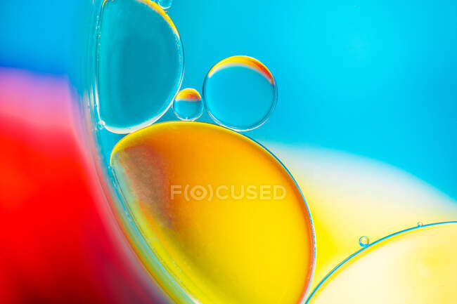 Closeup of abstract background with round shaped cells of vaccine of different sizes illuminated by colorful light — Stock Photo