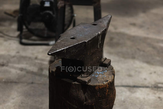 High angle of heavy steel or iron block used for repair of metal in blacksmith workshop — Stock Photo