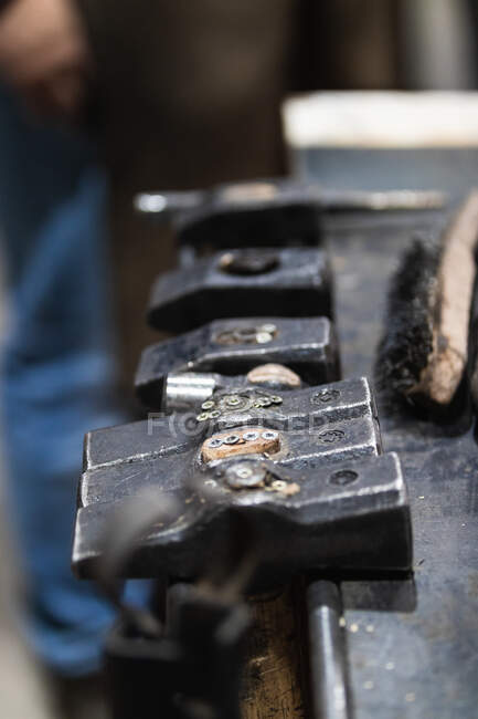 From above of hammers of different shape for repairing metal detail in blacksmith workshop — Stock Photo