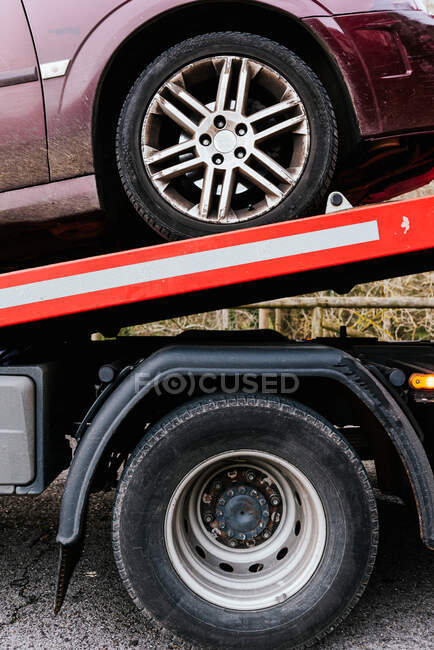 Side view of tow truck with car after breakdown on the highway — Stock Photo