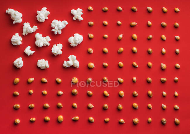 Closeup of some popcorn on a red background — Stock Photo