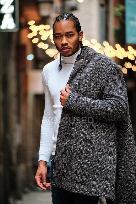 Black man standing on the street and looking at camera — Stock Photo