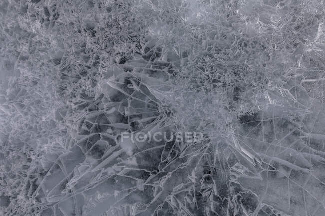 From above of frozen Lake Baikal surface with chaotic pattern and cracks as abstract background — Stock Photo