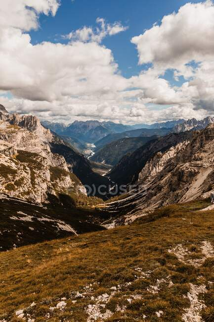 Spectacular scenery of Dolomite mountain range with rough rocky peaks under blue cloudy sky in daylight in Italy — Stock Photo