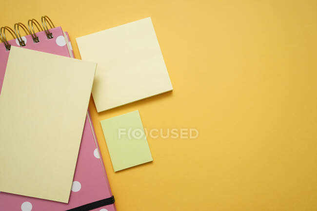 Colorful office supplies on yellow background — Stock Photo