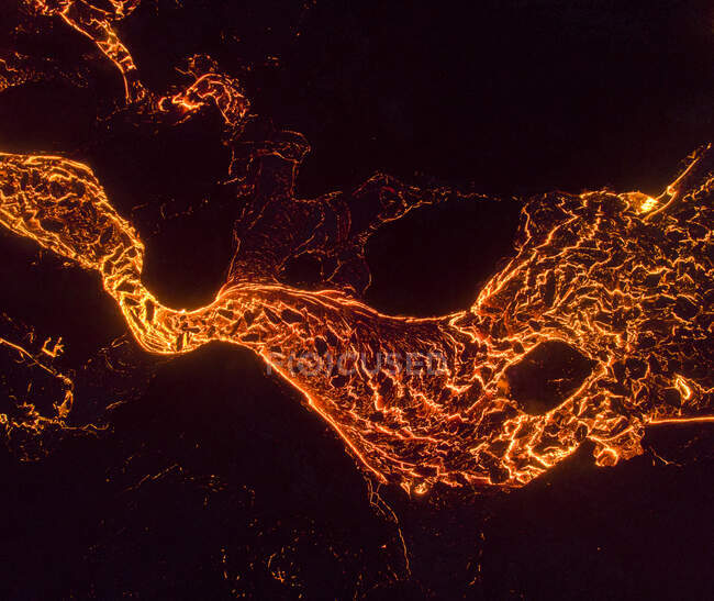 From above the magma of the volcano runs in the form of rivers of lava across the ground in Iceland — Stock Photo
