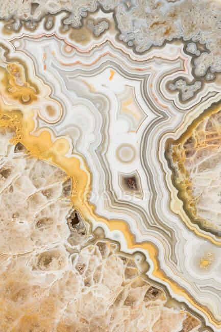Makrotexturaufnahmen der Farben und Muster in einem Spitzenachat aus Mexiko — Stockfoto