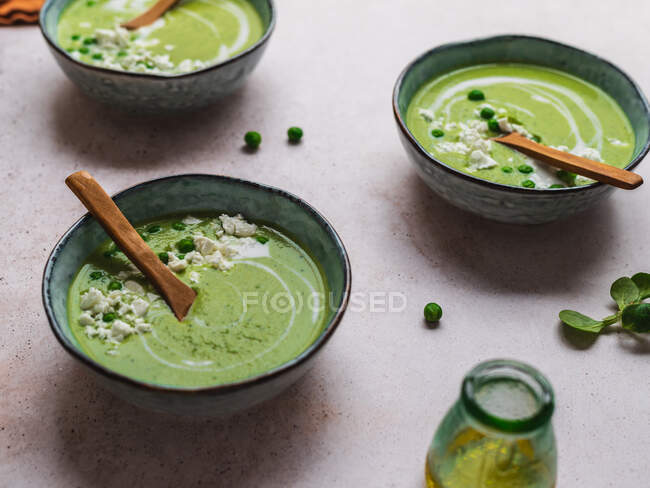 From above of delicious pea cream soup in bowls served on table — Stock Photo