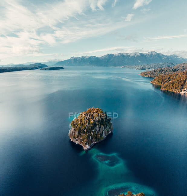 From above breathtaking aerial view of island in calm lake with turquoise water located in highlands — Stock Photo