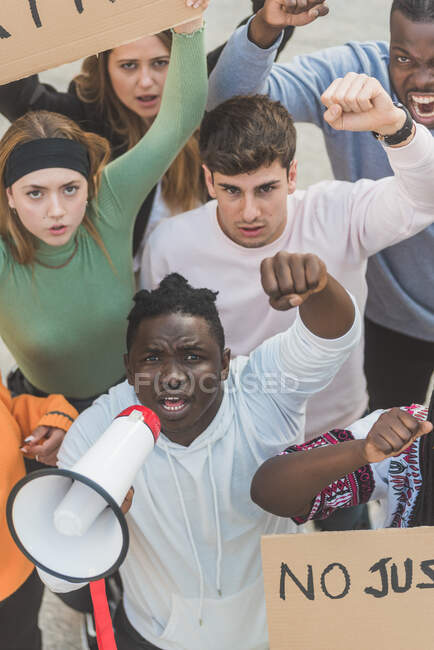 From above of crowd of multiracial people with posters screaming during Black Lives Matter demonstration in city and looking at camera — Fotografia de Stock