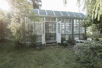 Glass house in garden at daytime — Stock Photo