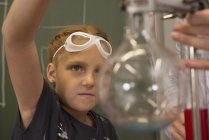 School girl with teacher doing experiments — Stock Photo