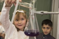 School students mixing liquid — Stock Photo
