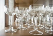 Crystal glasses arranging on a table — Stock Photo