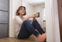 Senior woman having cup of tea — Stock Photo