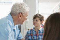 Smiling boy looking at grandfather — Stock Photo