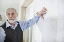 Architect presenting construction plan — Stock Photo