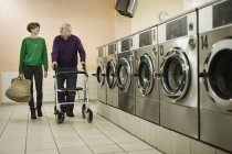 Man and woman are talking in laundry — Stock Photo