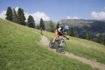 Mountain bikers riding on downhill — Stock Photo