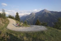 Mountain bikers riding on dirt track — Stock Photo