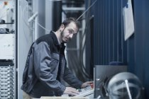 Engineer updating control panel — Stock Photo
