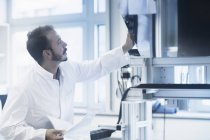 Scientist working in technology space — Stock Photo