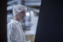 Clean room worker in an industry — Stock Photo