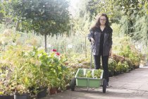 Woman working in garden — Stock Photo