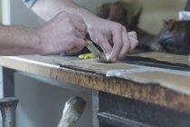 Shoemaker applying glue on shoe — Stock Photo
