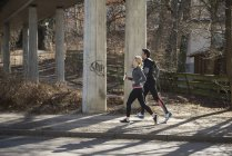 Man and woman jogging together — Stock Photo
