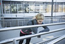 Exhausted jogger taking break — Stock Photo