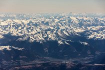 Rocky mountains with snow against sky — Stock Photo