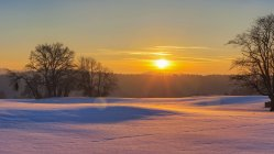 Sunset and snow field — Stock Photo