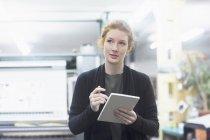 Contemplative female worker preparing list — Stock Photo