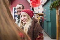 Friends standing at Christmas market — Stock Photo