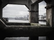 View of built structures on Bilbao river with construction crane in background — Stock Photo