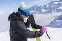 Female skier taking off ski skin, Bavaria, Germany, Europe — Stock Photo