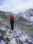 Woman hiking in the High Pyrenees ascending to mount Vignemale, Cauterets, France — Stock Photo