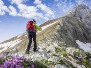 Mature woman ascending to mount Vignemale in High Pyrenees, Cauterets, France — Stock Photo
