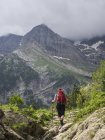 Mature female backpacker hiking at Cirque de Gavarnie in High Pyrenees, France — Stock Photo